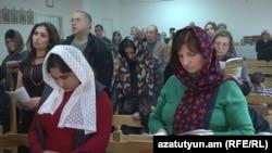 Armenia -- A prayer service in a Catholic church in Yerevan.