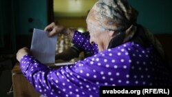 A voter in Slabada, outside the capital, Minsk, casts her ballot on September 11.
