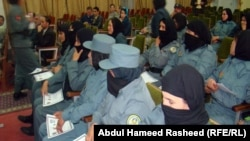 Afghan policewomen graduate from a training course. Militants frequently target women who work or study. Two senior female police officers were killed in the neighboring Helmand province earlier this year. (file photo)