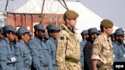 Afghan police and British NATO soldiers during a briefing at their military base in Lashkar Gah, Helmand Province, in February