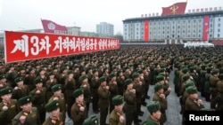 North Korean soldiers attend a rally celebrating the country's third nuclear test on Kim Il Sung Square in Pyongyang on February 14.