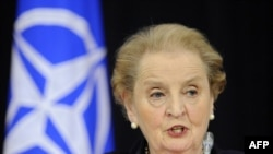 Madeleine Albright speaks to reporters at NATO headquarters in Brussels today after presenting her report to Secretary-General Anders Fogh Rasmussen.