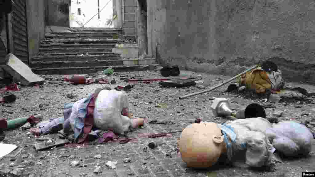 Toys are seen among the rubble of damaged shops in the Syrian city of Aleppo's al-Amereya district. (Reuters/Aaref Hretani)