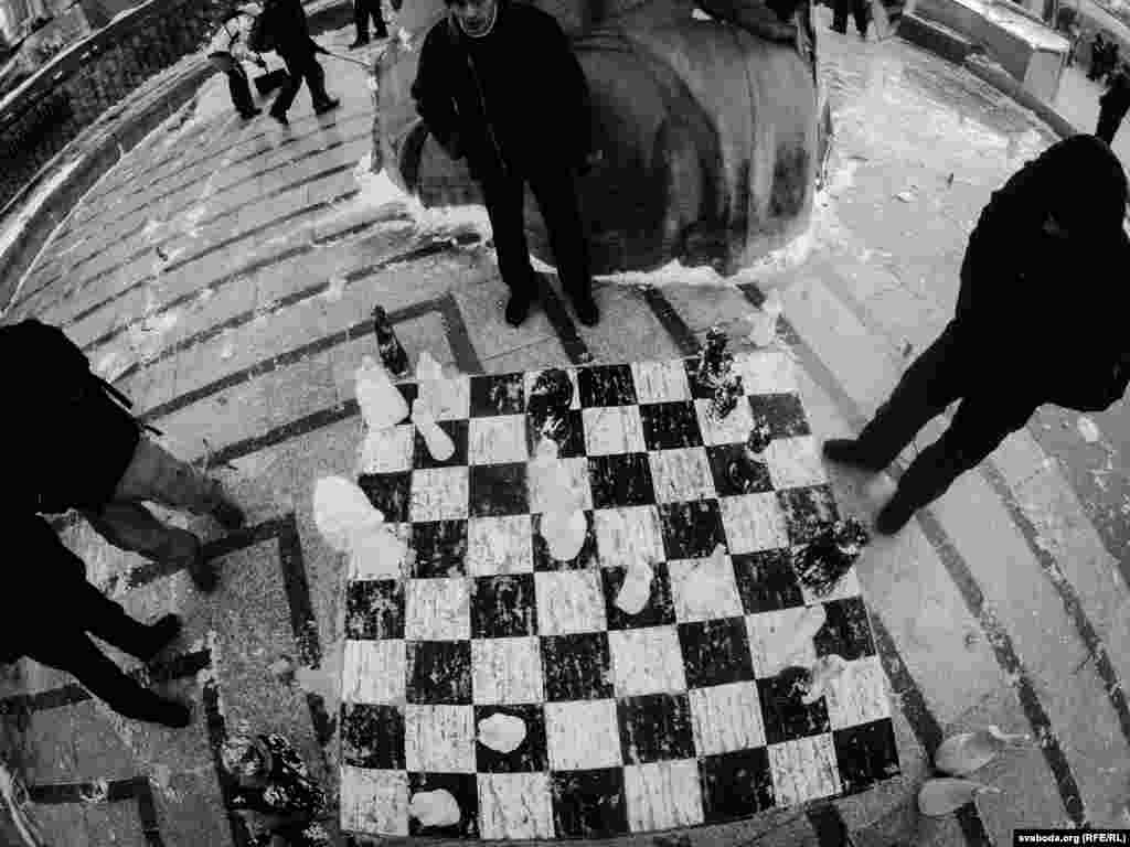 An outdoor chess game in the cold