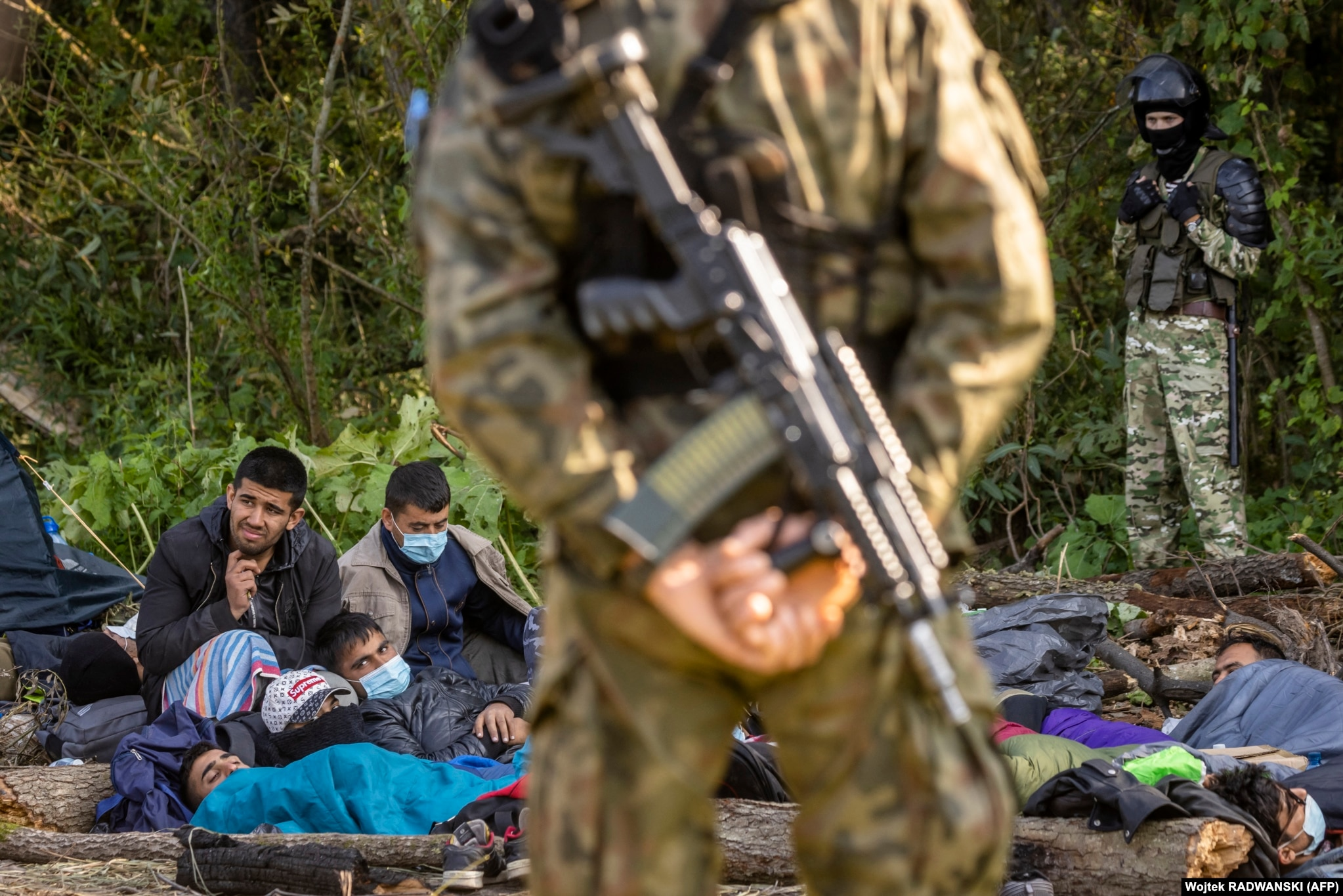 """The stranded migrants photographed on August 20.  Polish Deputy Foreign Minister Marcin Przydacz told reporters that the group near Usnarz Gorny""""are not refugees, they are economic migrants brought in by the Belarusian government."""""""