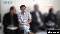 ژیائو وانگ، پژوهشگر آمریکایی- چینی در دادگاهی در ایران