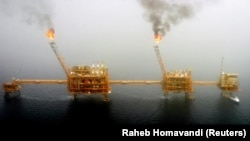 IRAN -- FILE PHOTO: Gas flares from an oil production platform at the Soroush oilfields in the Persian Gulf, south of the Iranian capital Tehran, July 25, 2005.