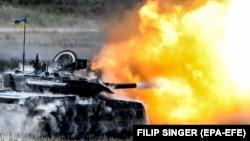 Ілюстраційне фото. Український танк Т-84 стріляє під час міжнародних навчань «Танковий виклик сильної Європи-2018». Німеччина, 8 червня 2018 року