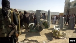 Afghan Taliban shows the wreckage of what they say is a U.S. plane shot down in southeastern Afghanistan on October 14.