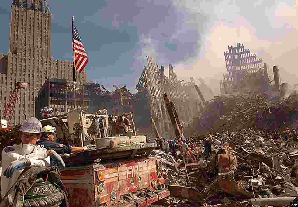 As it once was: Firefighters and rescue workers battle smoldering fires as they search for survivors at the ruins of the World Trade Center in New York on September 13, 2001.