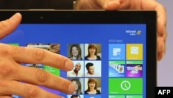 U.S. -- The Microsoft Windows 8 operating system is unveiled at a press conference in New York, 25Oct2012