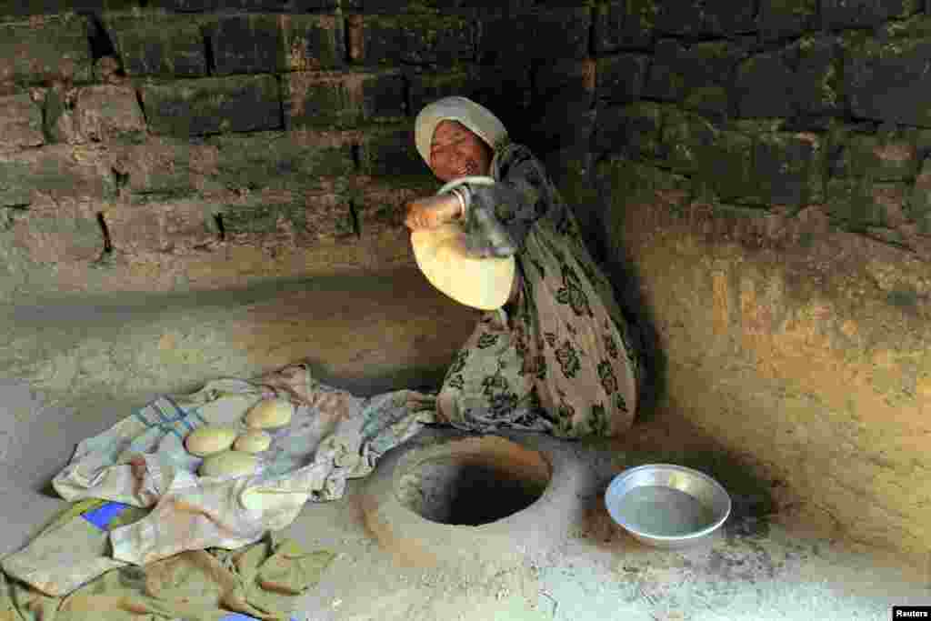 An Afghan woman bakes bread at her house outside Jalalabad. (Reuters/Parwiz)