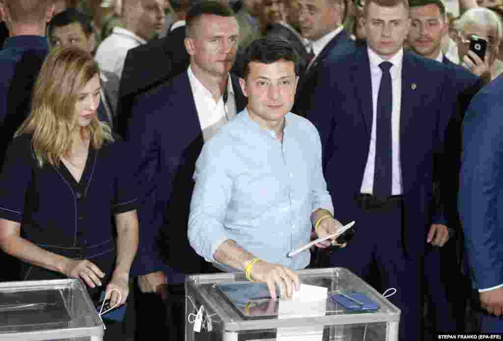 Ukrainian President Volodymyr Zelenskiy casts his ballot at a polling station in Kyiv.The 41-year-old former comedianportrayed Ukraine's president in a hit TV show. He faced a hostile parliament following his shock win in April's presidential election. He quickly called snap elections and has promised to bring in a new generation of politicians to lead the country. (EPA-EFE/Stepan Franko)