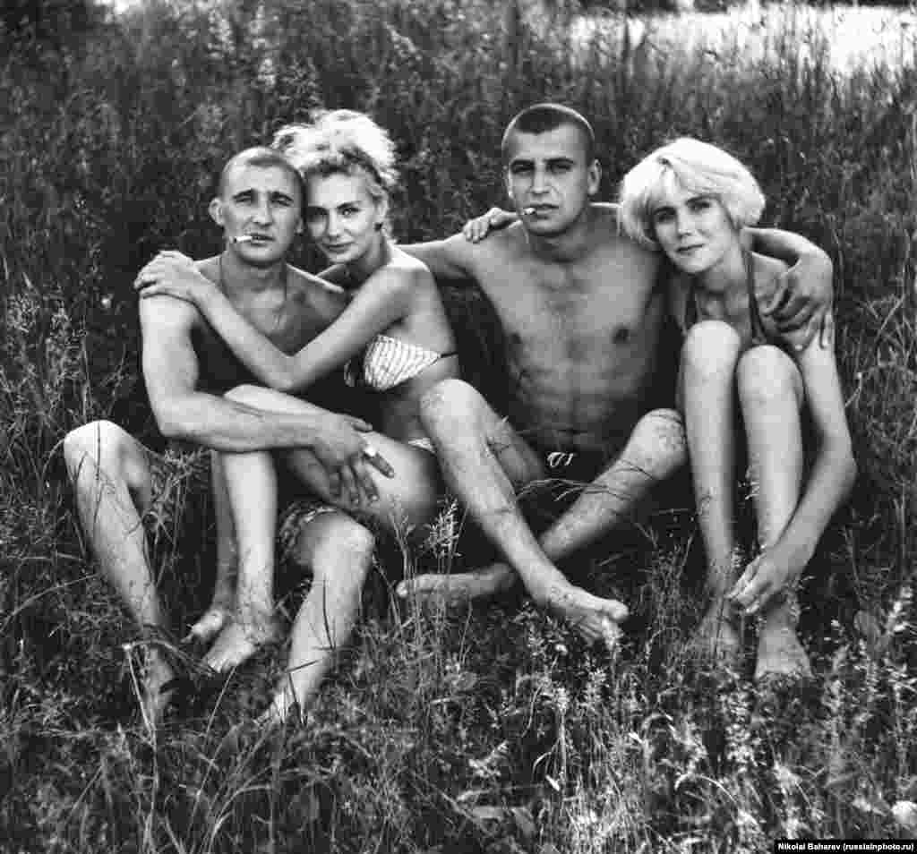 Young Russians relaxing in the sun. The photographer, Nikolai Baharev, grew up an orphan and worked as a locksmith, photographing people in his spare time. Today the 69-year-old exhibits in Europe's most prestigious galleries.