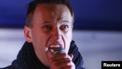 Political and social activist Aleksei Navalny speaks during an opposition protest in central Moscow on December 5.