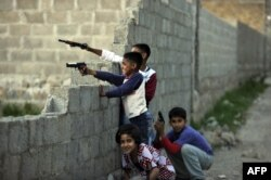 Pakistani children play with plastic guns in a street near Osama bin Laden's former hideout in Abbottabad in 2011.