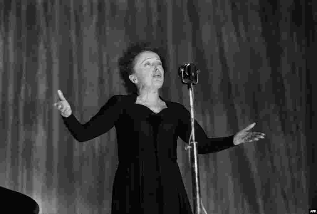 Piaf onstage at the Olympia during a show in Paris on December 30, 1960.