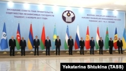 CIS representatives pose during a meeting in Tashkent on November 3.