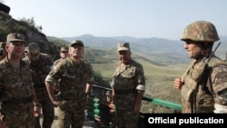 Armenia - Defense Minister Seyran Ohanian (second from left) inspects Armenian army positions on the border with Azerbaijan, 8Aug2012.