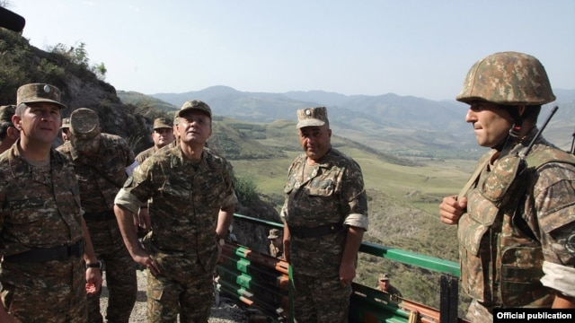 Armenia - Defense Minister Seyran Ohanian (second from left) inspects Armenian army positions on the border with Azerbaijan, 08Aug2012.
