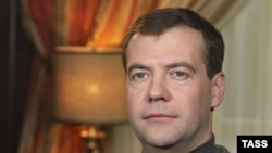"Medvedev, seen here recording a clip this month for his video blog, says ""freedom of speech must be ensured by technological innovations."" He doesn't say whose."