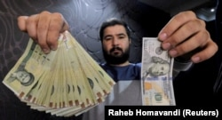 A money changer poses with a U.S. $100 bill and its rough equivalent in Iranian rials. (file photo)