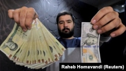 A money changer poses for the camera with a U.S dollar (R) and the amount being given when converting it into Iranian rials (L), at a currency exchange shop at Tehran's business district. File photo