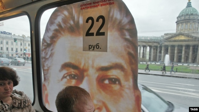 Stalin blocks a passenger's view of downtown St. Petersburg.