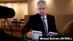 Dragan Covic casts his ballot. He campaigned on the creation of a Croat entity within Bosnia.