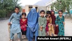 Orphans surround their grandmother Maryam.