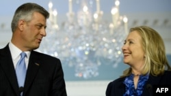 U.S. Secretary of State Hillary Clinton (right) and Kosovar Prime Minister Hashim Thaci in Washington on April 4