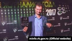Максим Николаенко с наградой