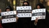 FILE: An Afghan women protest in Herat in March demanded a seat at the peace negotiations.