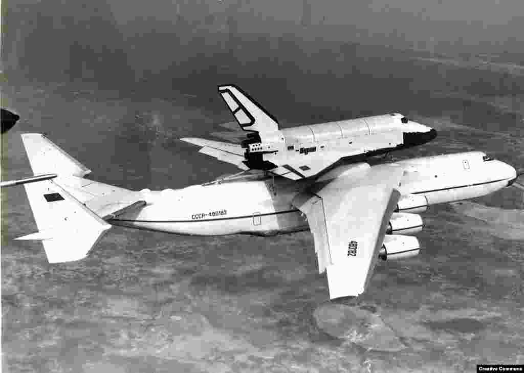 "The An-225 was designed in the Soviet Union to carry the Buran space shuttle (pictured) and the shuttle's rockets. Only one An-225 aircraft was built, first flying in 1988. Following the collapse of the U.S.S.R., the aircraft entered commercial service in 2001 with the name ""Mriya,"" which means ""dream"" in Ukrainian."