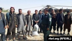 FILE: Militants surrender to Afghan forces in Jowzjan.