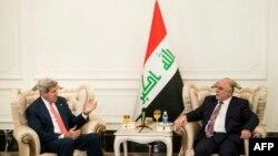 U.S. Secretary of State John Kerry (left) speaks with new Iraqi Prime Minister Haidar al-Abadi in Baghdad on September 10.