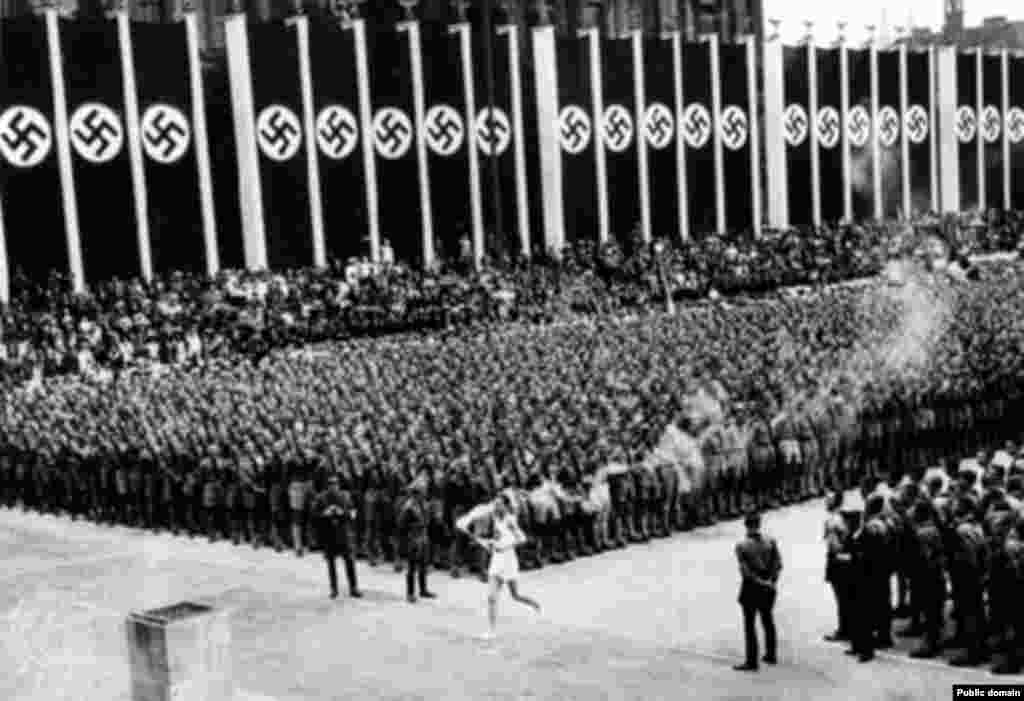 Torchbearer Fritz Schilgen carries the Olympic flame to open the Berlin Games in 1936, after a trip of 3,422 kilometers.