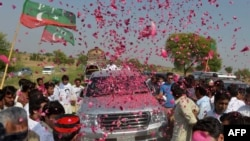 People welcome the convoy of cricket star turned politician Imran Khan on his way to a rally in Pakistan's tribal areas. His Tehreek-e Insaaf party is seen as somehting of a wild card in the country's upcoming parliamentary elections.