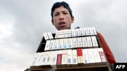 A young Afghan sells cigarettes in Kabul (file photo)