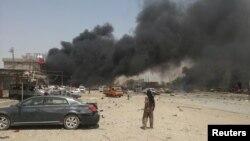 دخان متصاعد من موقع تفجير بسيارة مفخخة في طوز خورماتو