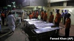 Staff of a local hospital in Karachi wait for casualties of bomb blast at a Sufi shrine in Shah Noorani, in Balochistan province near Karachi.