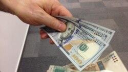 Бонки миллӣ: Доллар 11 сомонӣ намешавад