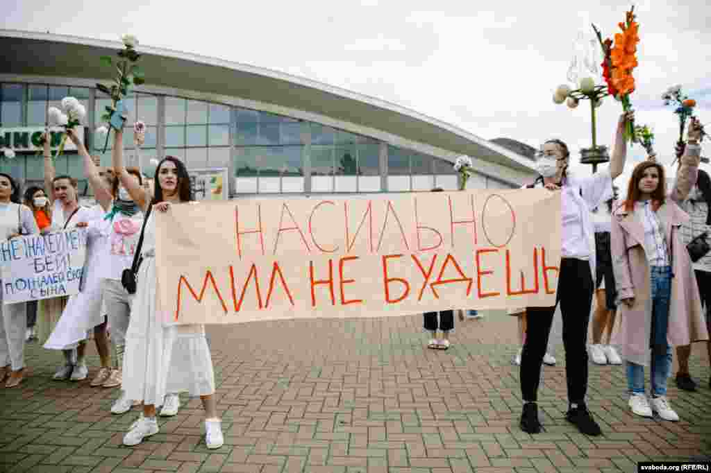 "A protest by women in Minsk on August 12. The sign says, ""Love cannot be forced."""