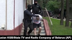 Belarusian KGB officers detain a Russian man in a sanitarium outside Minsk on July 29.