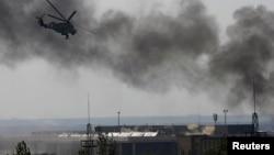 Өкмөттүк аскерлер Донецк аэропортун бошотууда Mи-24 куралдуу тик учактарын жана башка аскердик учактарын колдонушту, 26-май, 2014