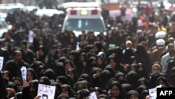 Antigovernment protesters attend the funeral of a comrade who died a day earlier from his wounds following clashes with police, in the town of Jidhafs on February 15.