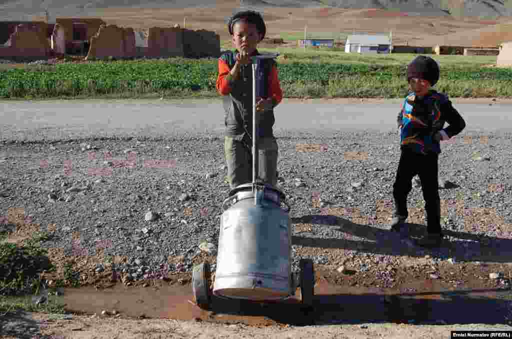 Kyrgyz children haul water in the village of Kara-Kabak.