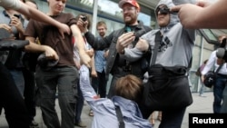 "Russians attacking a gay-rights activist during a protest against the draft of the law against ""gay propaganda"" before the State Duma in early June."