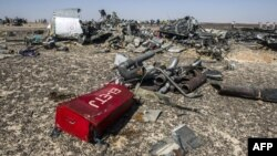 Debris is strewn in the desert at the site of the crash of Kogalymavia/Metrojet Flight 9268 on the Sinai Peninsula.