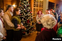 Ukrainian President Petro Poroshenko and his wife, Maryna, meet with Christmas singers in the Ivano-Frankivsk region of western Ukraine.